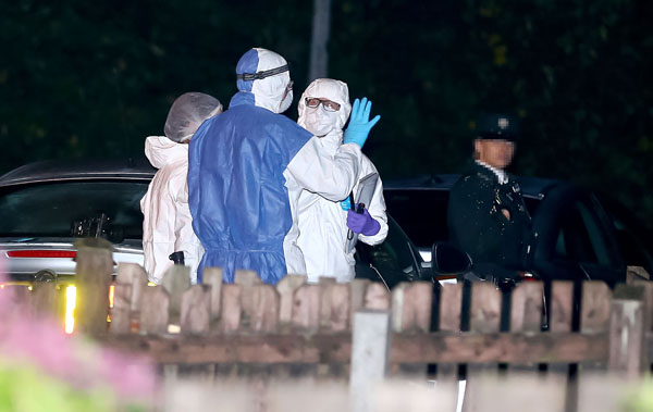 PSNI and forensics at the scene on Monday night     Pic by Kevin Scott