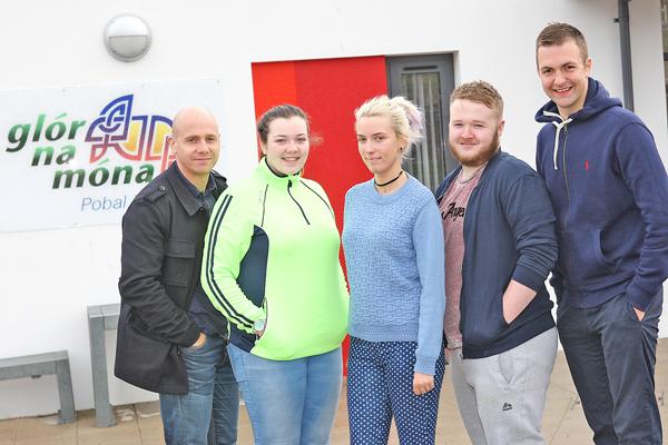 FÁILTE: Caoimhe Nic Cúuladh, Chrissie Poland and Gerard McGuiness at Gael-Ionad Mhic Goill on the Whiterock Road with Niall Enright, left, and Conchur Ó Muadaigh, right, of Glór na Móna