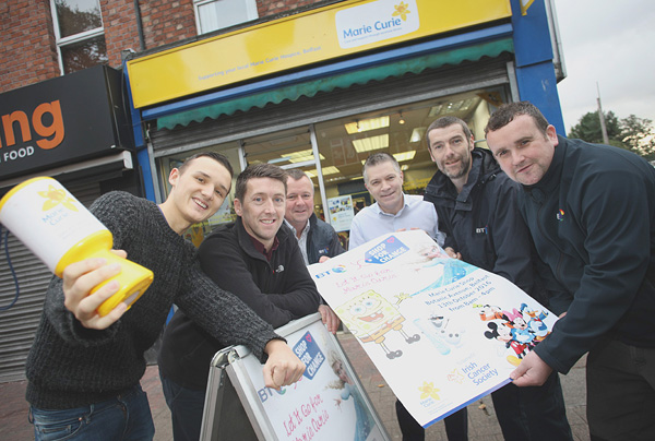 Paul Cunningham and Jamie Holland of the Marie Curie Charity Shop in Botanic Ave with Ray McDonnell, James Nolan, Chris Collins and John Breen of BT