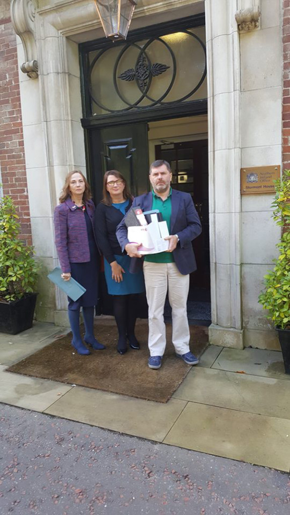 Carmel Quinn, Andrée Murphy and Mark Thompson with RFJ's collusion report, the de Silva review of the murder of Pat Finucane, John Stevens' third report on collusion and the Cory reports on collusion, which they presented to the British Secretary of State