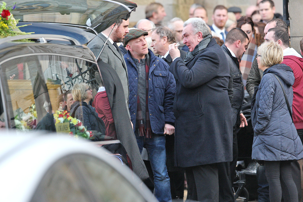 Mourners, including boxer Eamonn Magee, at the Requiem Mass for James Hughes