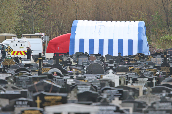The scene in Milltown Cemetery on Monday as the exhumation of the body of Daniel Rooney began