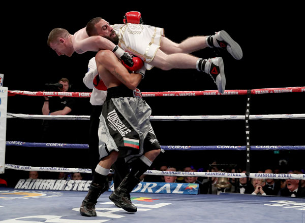 Paddy Barnes is lifted by opponent Stefan Slachev during their flyweight bout at Belfast's Titanic Exhibition Centre on Saturday night. The Hungarian was subsequently disqualified by referee Hugh Russell Jnr