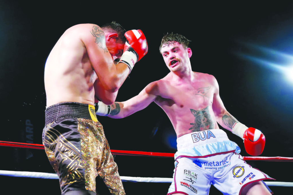 Tyrone McKenna takes on Dublin's Sean Creagh at the Titanic Exhibition Centre on Saturday night