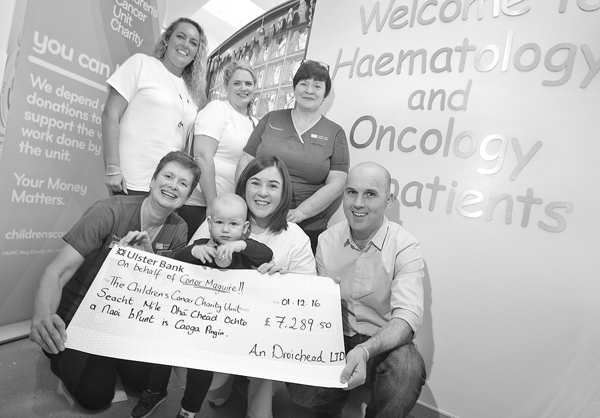 Seaneen O'Loan and Tara Gibney along with Catherine, Ciaran and their son Conor present deputy ward sisters Patricia Fleck and Gail Burns of the Haelatology and Oncology unit in the Children's Hospital with a cheque for £7289.50 on behalf of An Droichead. 1112mj16