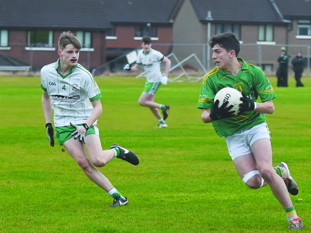 Sean Elliott goes on the attack for Dunloy as Ardan McAvoy looks on