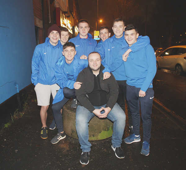 Paddy Doyle with members of the Turas Youth project on the Antrim Road
