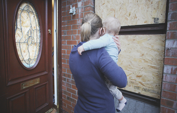 Sylwia Rossa-Orlowska outside her Downview home with her baby son after the racist attack