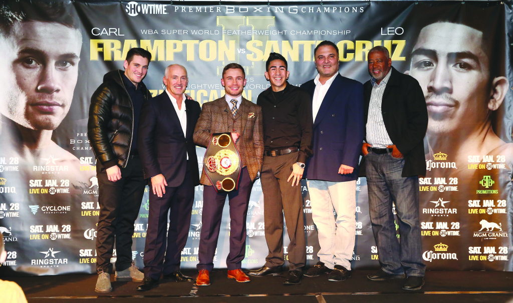 Carl Frampton and Leo Santa Cruz are joined by (L-R) Shane McGuigan (Frampton's trainer), Barry McGuigan (Frampton's manager), Richard Schaefer (Ringstar Sports promoter) and Sam Watson (Al Haymon representative) at Tuesday's press conference at the Europa Hotel to promote the rematch between Frampton and Santa Cruz on January 28 in Las Vegas Press Eye - Photo by William Cherry