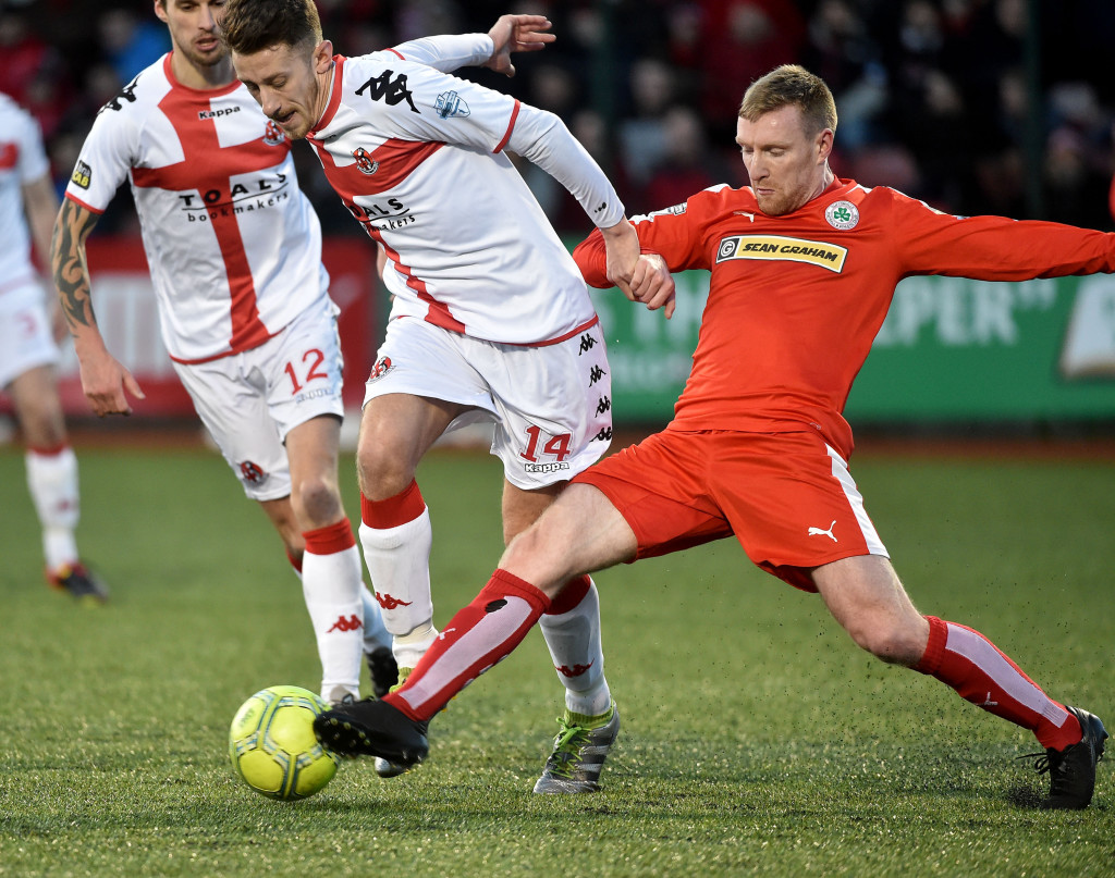 Cliftonville's Chris Curran in action with Jordan Forsythe of Crusaders during the North Belfast derby on St Stephen's Day. Reds boss Gerard Lyttle has called on his side to bounce back from their 4-0 defeat when they face Glenavon on Friday night