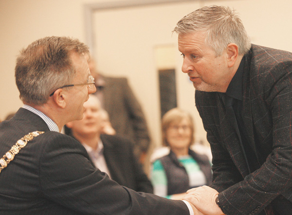 Fr Gary Donegan with DUP Mayor Brian Kingston at the Houben Centre