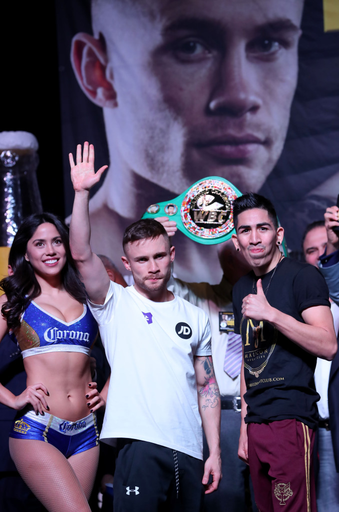 Carl Frampton and Leo Santa Cruz salute the fans at yesterday's weigh-in Photo William Cherry/Presseye
