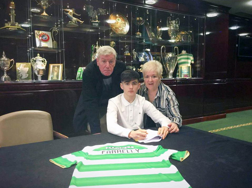 NAME ON THE SHIRT: Connor with his grandparents Rosaleen and Eamon Henry signing for Celtic in the Parkhead trophy room