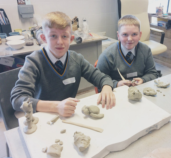 VALUABLE LESSONS: Aidan Bradley and Mathew Murphy get to grips with clay modelling