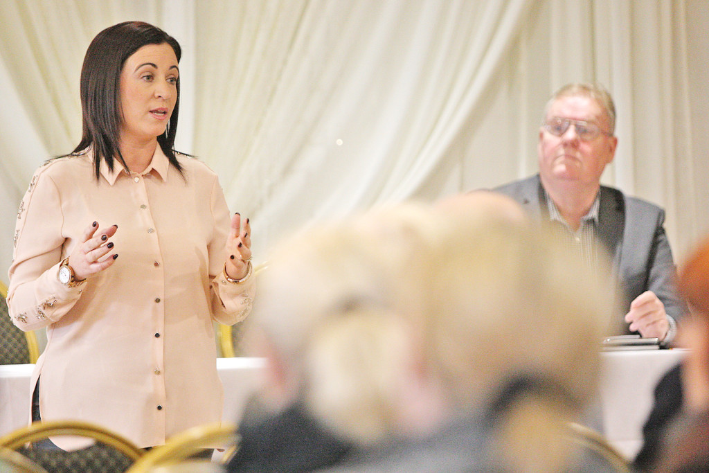 Julieann McNally in the Balmoral Hotel during a public meeting on Dunmurry Manor