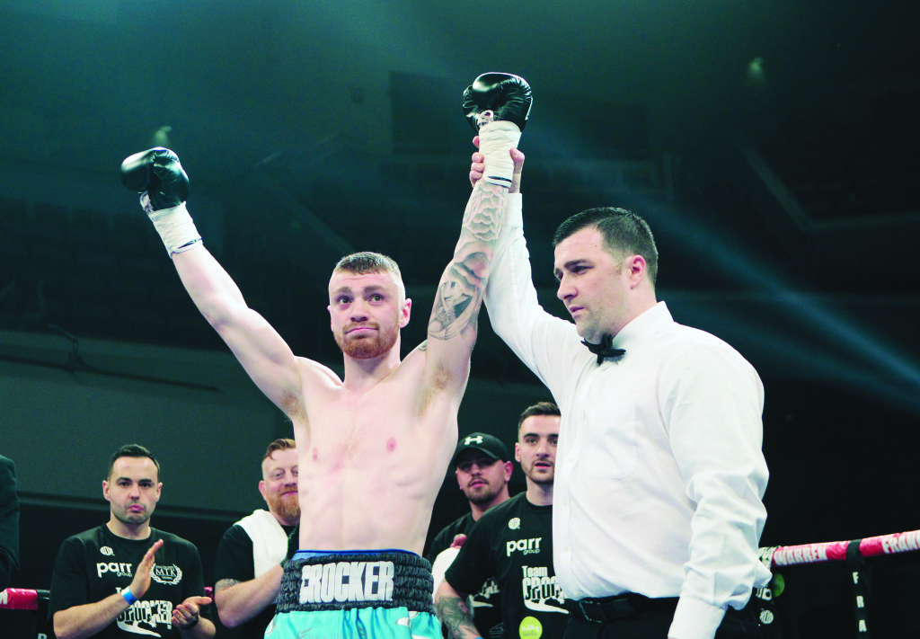 Lewis Crocker celebrates his debut win