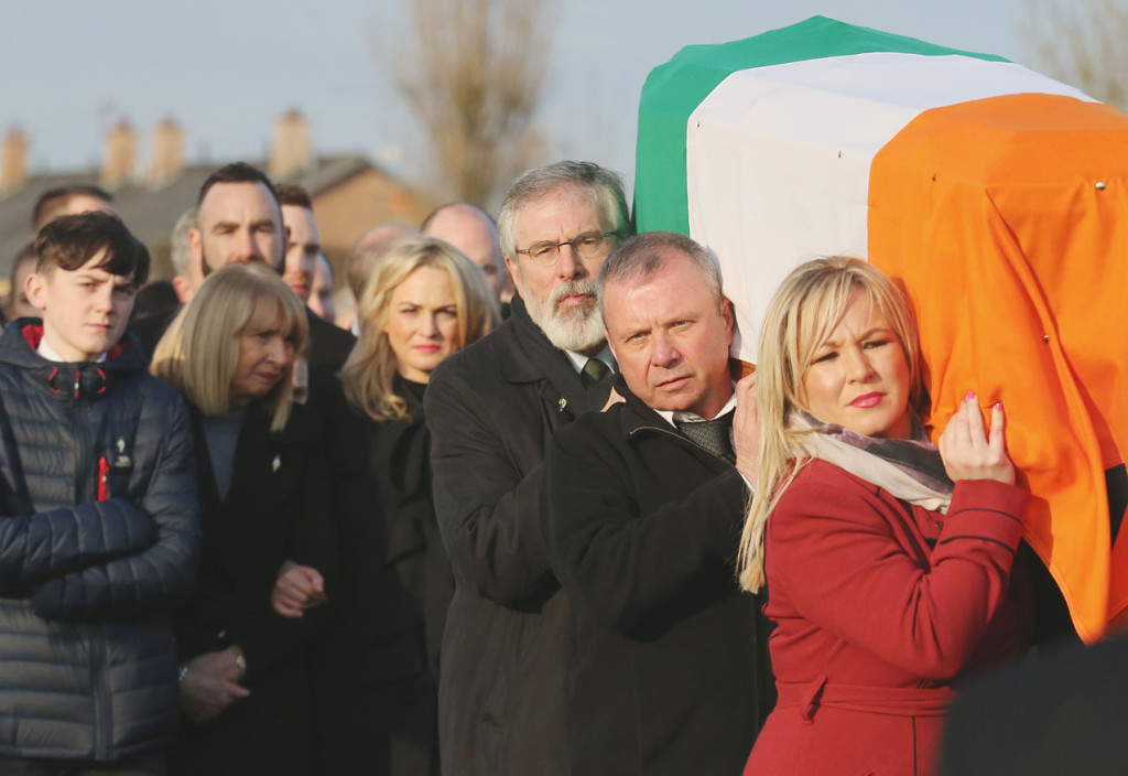 Gerry Adams and Michelle O'Neill shoulder the coffin of Martin McGuinness