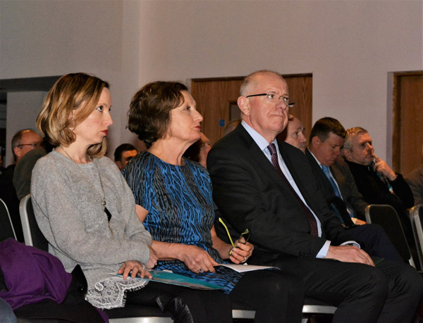 TOGETHER:Pat Finucane's daughter Katherine and wife Geraldine sit with Irish Minister for Foreign Affairs Charlie Flanagan at the Pat Finucane Lecture held in the Europa Hotel   pic by @antrimlens