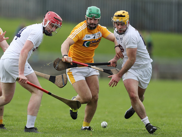Antrim's Ciaran Johnston in action against Kildare's Mark Dleaney and Chris Bonus