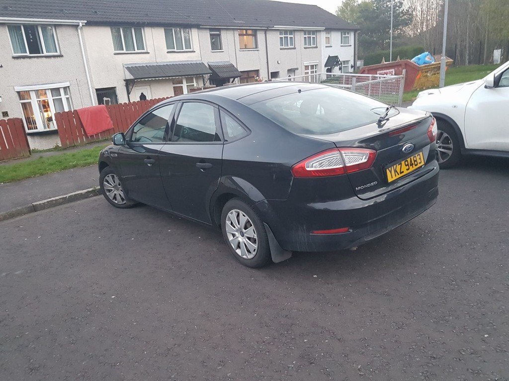 The black Ford Mondeo at the scene of the alert at Azlaea Gardens Twinbrook