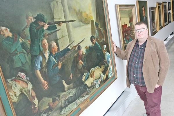 The Cultúrlann's Concubhar Ó Liathain with the 1916 painting by Thomas Ryan