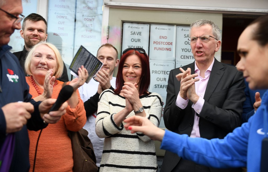 As Rosario Chair Noel Savage finishes speaking at the protest on Friday, he's applauded by political reps Máirtín Ó Muilleoir, Clare Bailey, Lily Kerr and Gerry Carroll