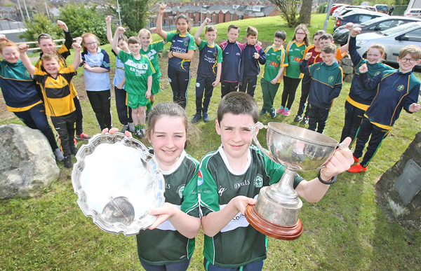 The launch of the Liam Murray Cup in Coláiste Feirste with Liam and Amy Murray, along with the pupils from Irish language schools, who are competing in this year's 2017 competition