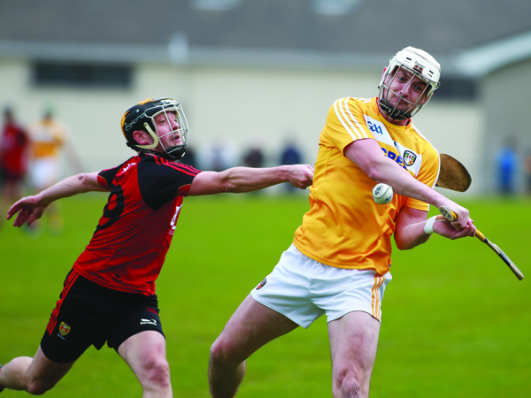 Antrim's Conor McKinley is chased by Down's Scott Nicholson during the meeting between the side's three weeks ago