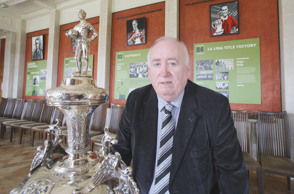SILVERWARE: Fra McCann MLA at the exhibition on the life of ex-Belfast Celtic player Patrick O'Connell