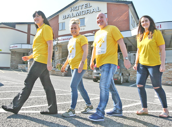 STEPPING OUT: Marie Therese Morgan, Sharon Fennell, Mark McCabe and Grace Smyth gear up for the charity walk which is taking place this Saturday morning on Divis Mountain