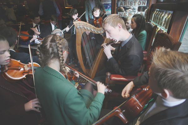 SUMMER FUN: Young musicians in the Dark Horse at the launch of the inaugural trad music school