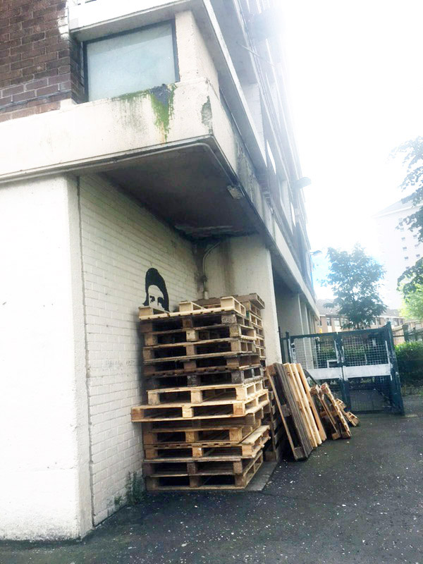 LETHAL: Pallets stacked underneath one of the seven New Lodge tower blocks have pushed residents to breaking point as the danger of flammable materials in residential areas continues