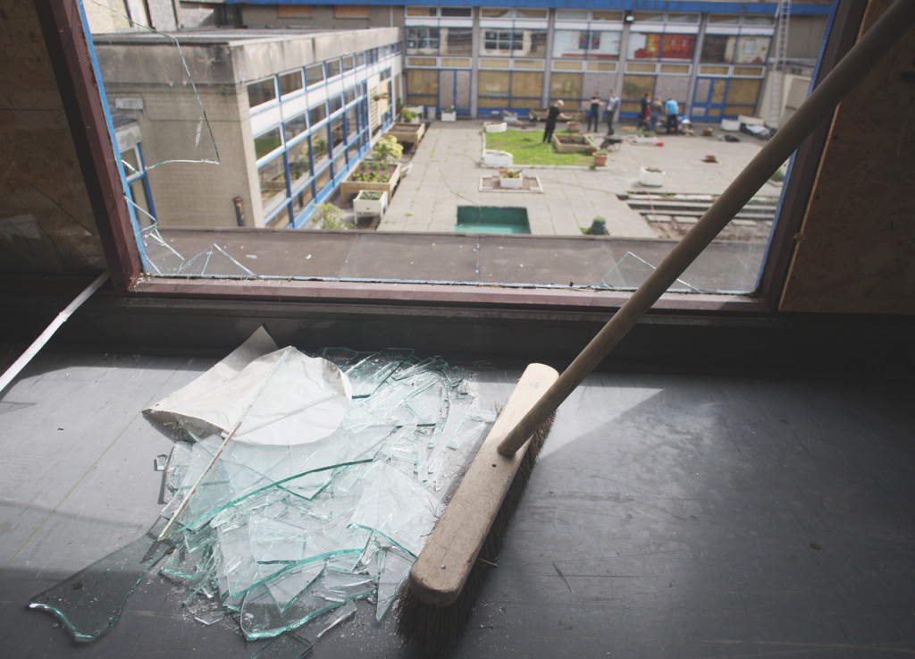 DISGRACE: The clean-up begins at the old St Gemma's School after it was vandalised once more