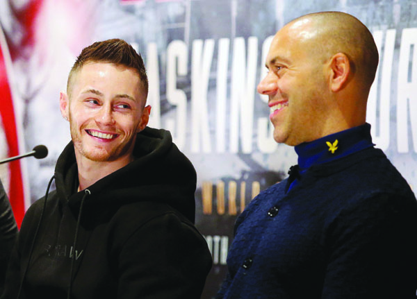 Ryan Burnett shares a joke with his trainer, Adam Booth