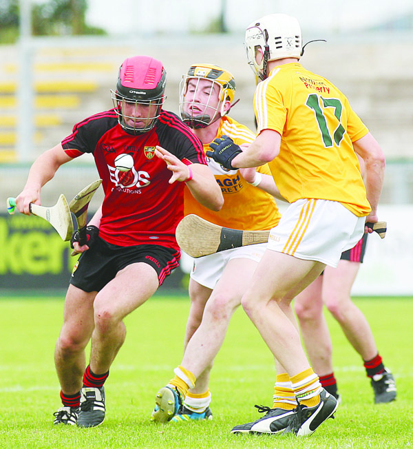 Antrim's Conor Boyd and Ed McQuillan challenge Down's Ruairi McCrickard during last year's Ulster MHC final in Owenbeg. The Antrim duo are expected to feature for Collie Murphy's side at Corrigan Park on Sunday when they host the Ardsmen
