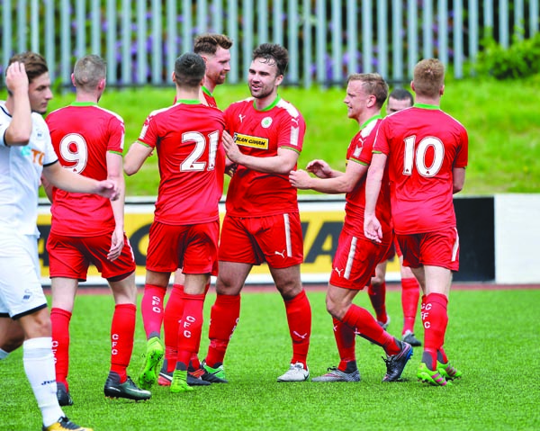 Cliftonville players celebrate Garry Breen's goal against Swansea U23s on Saturday