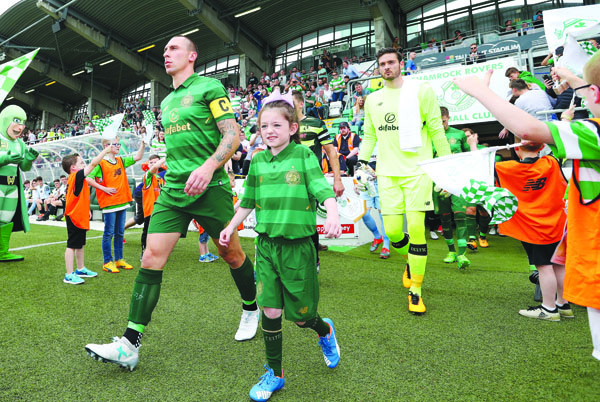 Celtic's Scott Brown leads his team out against Shamrock Rovers before last Saturday's 9-0 win at Tallaght Stadium. The Celtic skipper is expected to shake off an Achilles problem to feature against Linfield at Windsor Park on Friday evening
