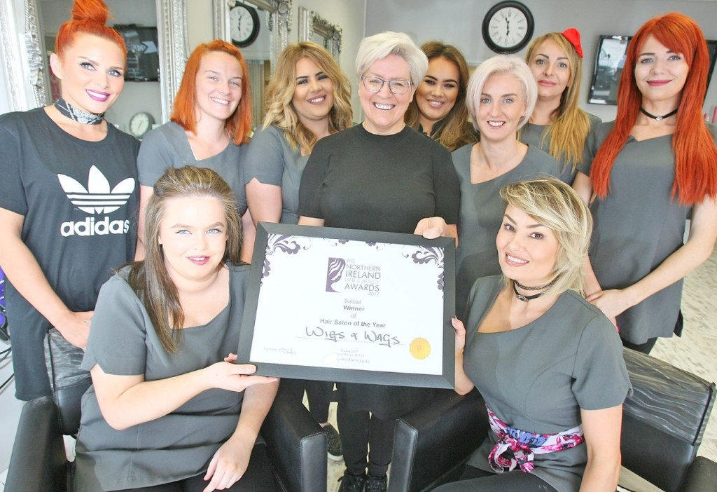 WELL DONE: Ann Bradley with the staff at Wigs & Wags with their Hair Salon of the Year award
