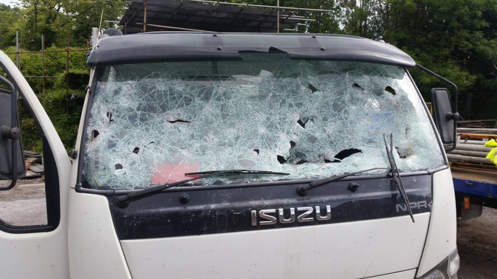 MINDLESS: One of the three vans badly damaged in the attack