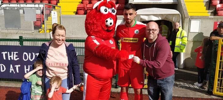 Lorraine Conlon, her husband, John, sons Finn (5), Luca (3) with Cliftonville mascot 'Red Arnie' and Joe Gormley on a recent visit to Solitude