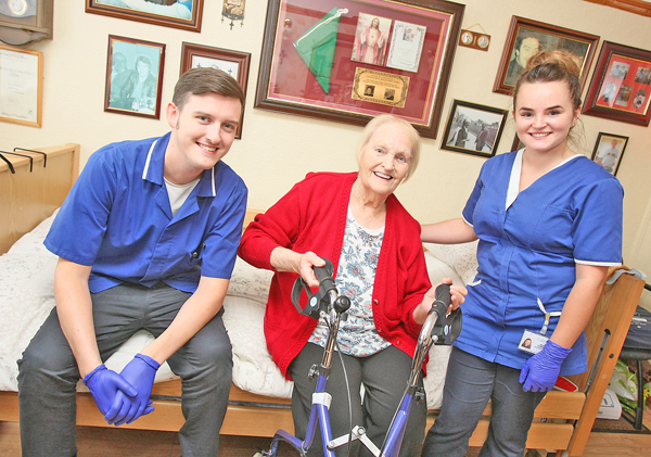 GREAT FAITH: Ballymurphy resident Alice Toner with Colin Care staff Ruairi and Megan