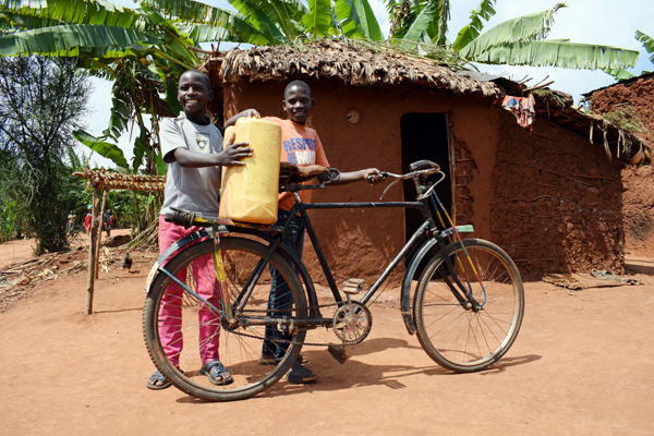ORPHANED: Brothers  Jean Nshimirimana and Clovis Kwizerimana faced adversity after the death of their parents – a new home and a bicycle courtesy of Concern have given them the hope of better future