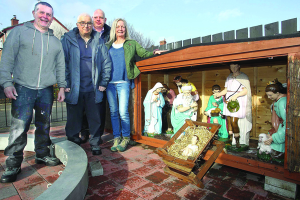 FESTIVE FEELING: Colm Denvir (left) and Seamus Kelly from Bawnmore Community Association with John Read from the Housing Executive and artist Janet Crymble at the nativity scene in Bawnmore, restored with help from a £3,000 grant from the Housing Executive