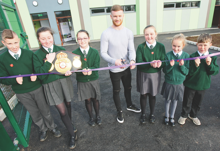 St Kieran's Primary School pupils Shay Fox, Casey McKeaveney, Chanel Quinn, Niamh Willoughby, Chelsea Fennel and Patrick Robinson, with boxing champion James Tennyson, opening the new changing rooms at Sally Gardens