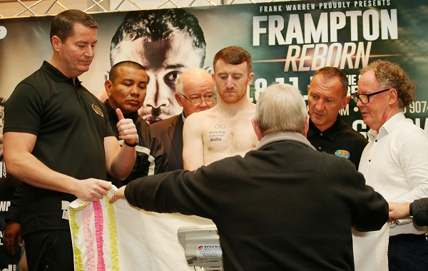 Paddy Barnes is protected by a towel as he removes his underwear to make the weight.   Picture by Jonathan Porter/PressEye.com