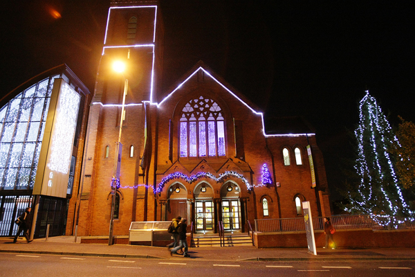 Christmas Tree at the Culturlann and Nolliag Shona sign over the Falls Road. 32611mj12