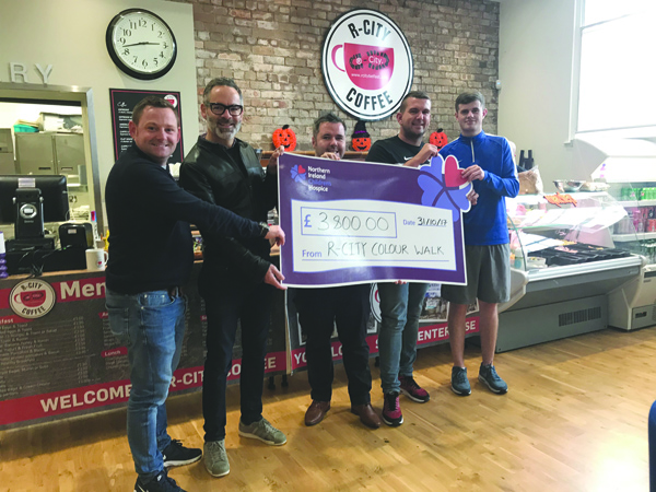 Michael Nugent, Regional Fundraiser from NI Children's Hospice, receiving the cheque of £3800 from representatives of The Wall Group and R City at The Houben Centre