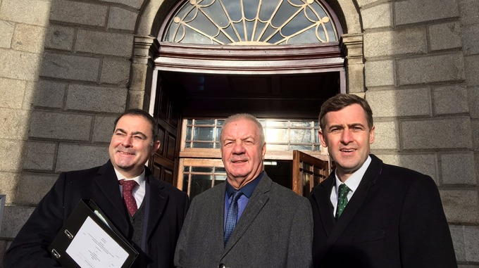 Raymond outside the Four Courts in Dublin with his legal team from McIvor Farrell