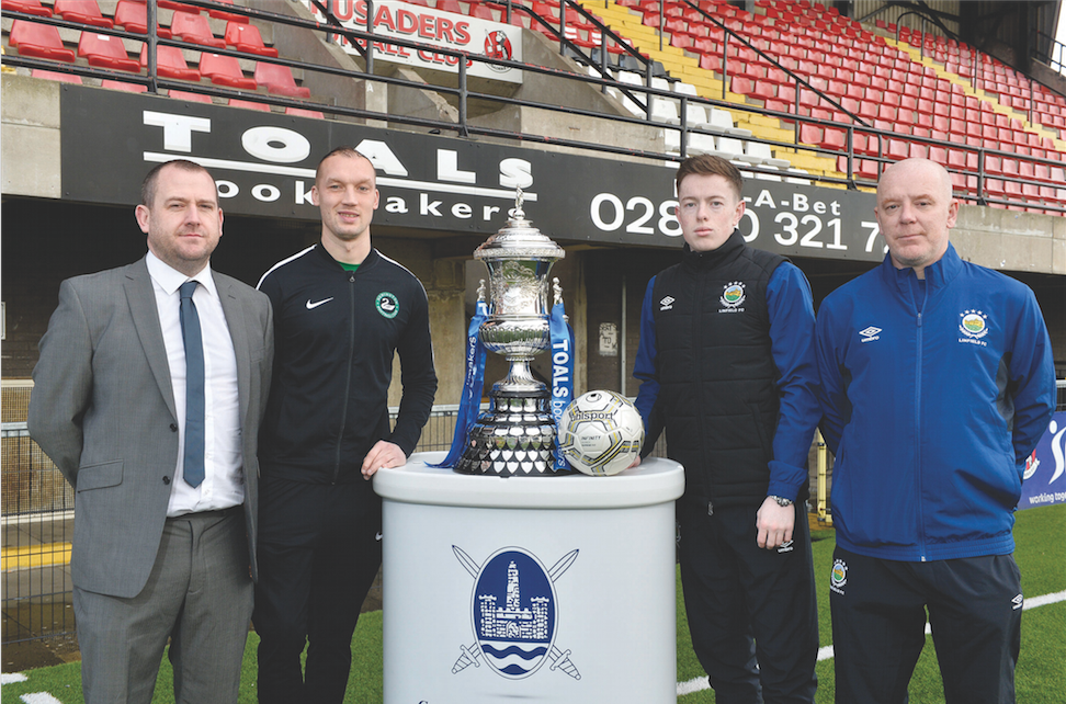 Newington manager Conor Crossan pictured with goalkeeper Dean Smyth, Linfield Swifts goalkeeper Alex Moore and Linfield Swifts boss David Dorian and the Steel and Sons Cup ahead of the Christmas Day decider at Seaview
