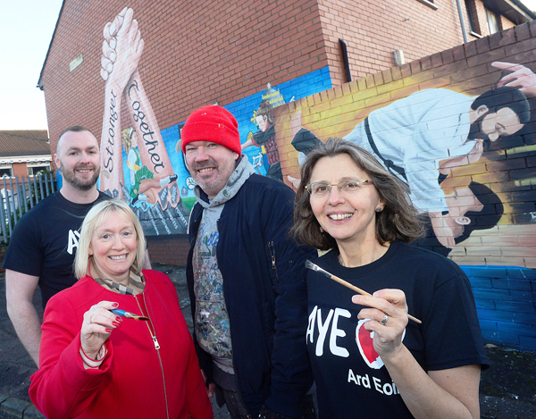 GREAT WORK: Seán Breen (Ardoyne Youth Enterprises Youth Engagement Officer), Amanda Ashe (Housing Executive Community Cohesion Officer), artist Michael Doherty and Catherine Couvert (Ardoyne Youth Enterprise Communications Officer) at the new mural in Havana Court in Ardoyne